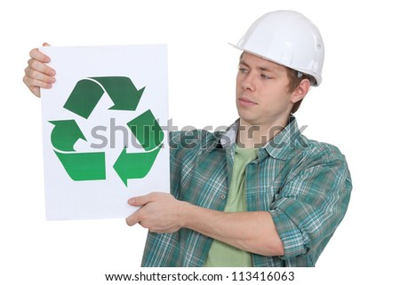 Curious worker holding recycle logo - stock photo