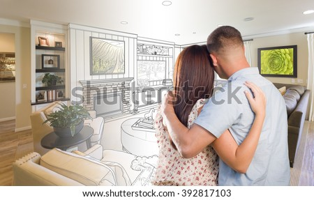 Curious Young Military Couple Looking Over Custom Living Room Design Drawing Photo Combination. - stock photo