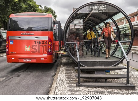 CURITIBA, BRAZIL - APRIL 4: The public transportation of Curitiba with its integrated bus stops is a landmark of Curitiba in Parana, Brazil and an model for the country photographed on April 4, 2014. - stock photo