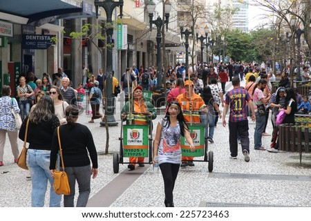 CURITIBA, BRAZIL - OCTOBER 7, 2014: People shop in pedestrian zone of Curitiba, Brazil. Curitiba is the 8th most populous city of Brazil with 1.76 million inhabitants. - stock photo