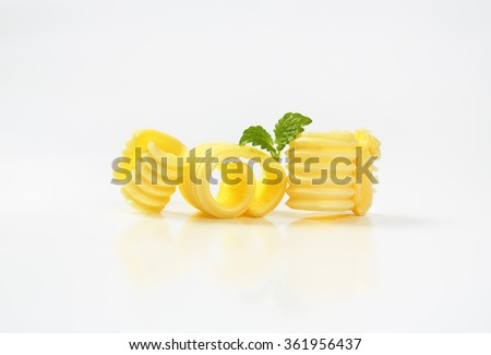 Curl of fresh butter on white background - stock photo
