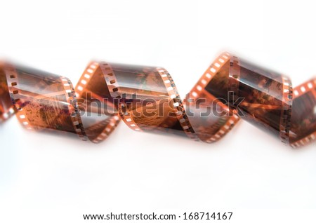 Curled film ribbon isolated on white - stock photo