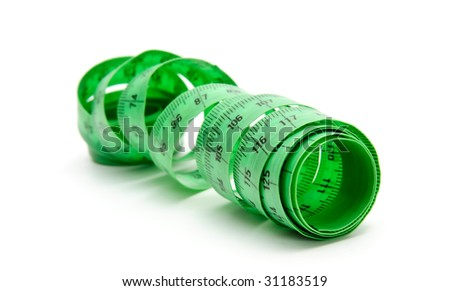 Curled green measuring tape on white background - stock photo