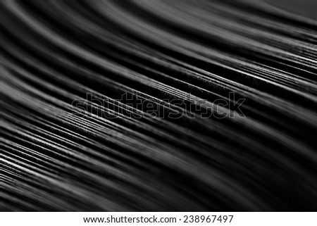 curled in a roll black paper ribbon. Macro lens closeup shot 1:1 - stock photo