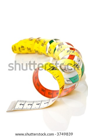 Curled measuring tape reflected on white background - stock photo
