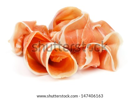 Curled Slices of Delicious Prosciutto isolated on white background - stock photo