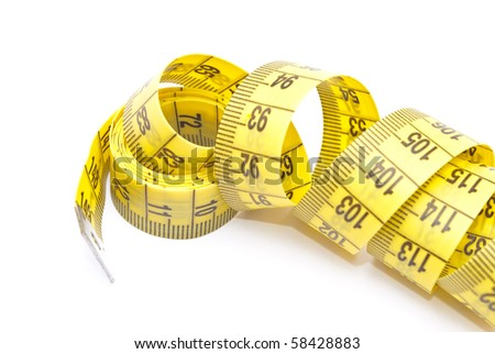 Curled yellow measuring tape - stock photo