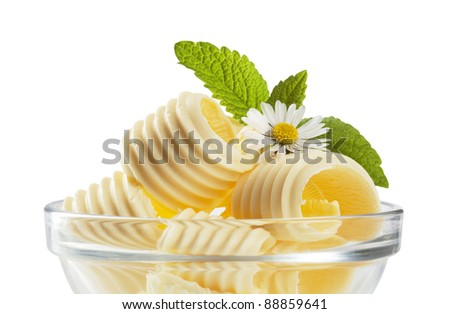 Curls of fresh butter in a bowl - stock photo