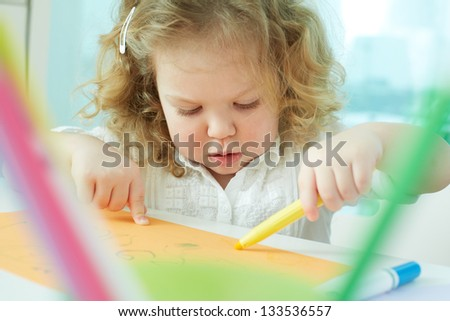Curly beauty learning how to draw - stock photo