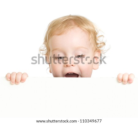 Curly child holding blank advertising banner - stock photo