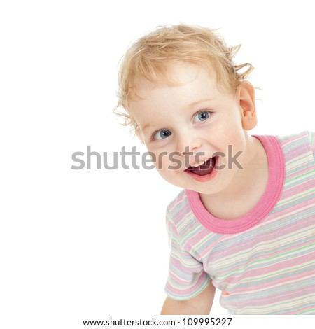 Curly cute child playing hide and seek - stock photo