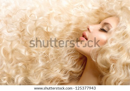 Curly Hair. Fashion Girl With Healthy Long Wavy Hair. Beauty Blonde Woman Portrait. Blond Hair, Hair Extension, Permed Hair - stock photo