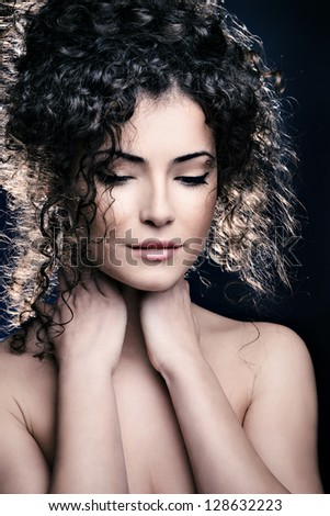curly hair  young woman beauty portrait studio shot - stock photo