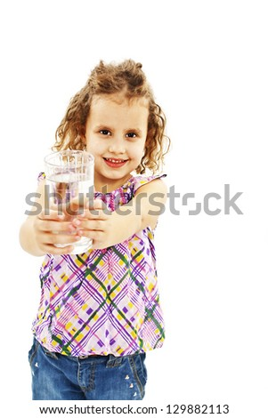 Curly little girl with glass of water. Isolated on white background - stock photo