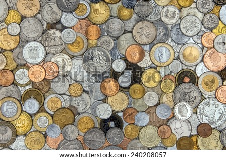 Currency - A collection of old coins from around the world. - stock photo