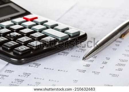 Currency cross-rate table, calculator and a pen; concept of financial analysis - stock photo