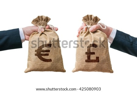 Currency exchange concept. Hands holds bags full of money - British pounds and Euro. Isolated on white background. - stock photo