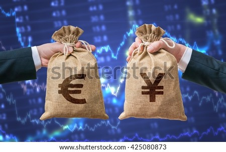 Currency exchange concept. Hands holds bags full of money - Euro and Yen. - stock photo