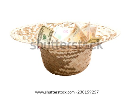 Currency on a white background in women's hat isolated - stock photo