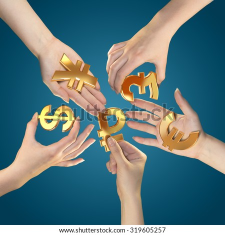 Currency symbols in hands. - stock photo