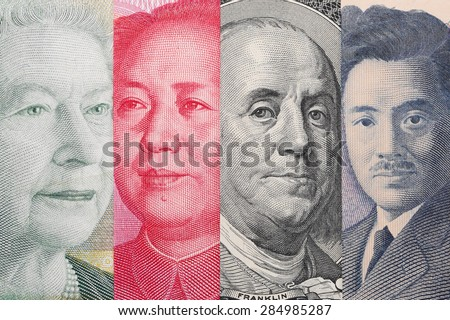 Currency War. Photo Shows Canadian, Chinese, US and Japanese Banknotes - stock photo