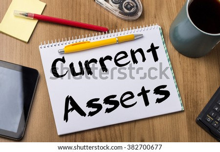 Current Assets - Note Pad With Text On Wooden Table - with office  tools - stock photo