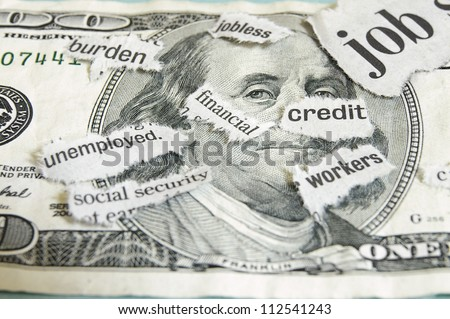 current event newspaper headlines on money - stock photo