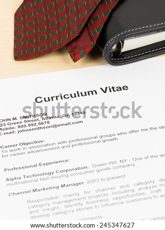 Curriculum vitae or CV with organizer and neck tie; concept job applying - stock photo