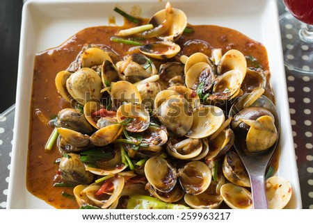 Curry fried clams, delicious Thai food. - stock photo