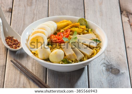 Curry Laksa which is a popular traditional spicy noodle soup from the Peranakan culture in Malaysia and Singapore - stock photo