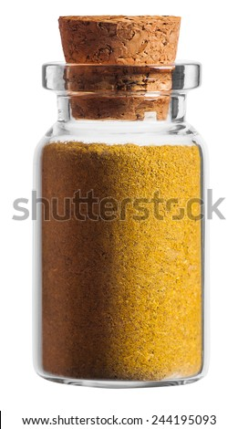 Curry spice in a little bottle isolated on white background - stock photo