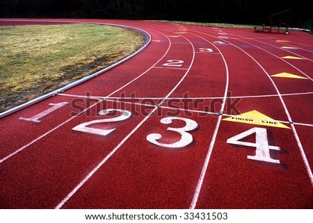 Curve Ahead on a red running track. - stock photo