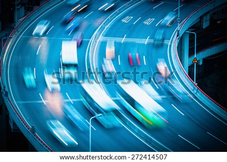 curve bridge approach closeup , vehicles motion blur as a busy traffic background - stock photo