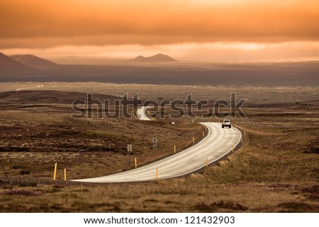 Curve Highway through Iceland landscape. Toned image - stock photo
