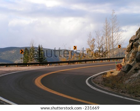 Curve in road - stock photo