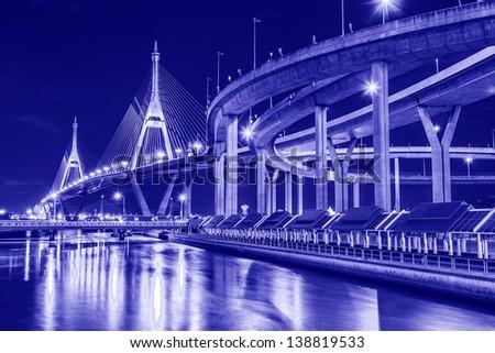 Curve of suspension bridge at riverside in twilight scene(Bangkok, Thailand) - stock photo