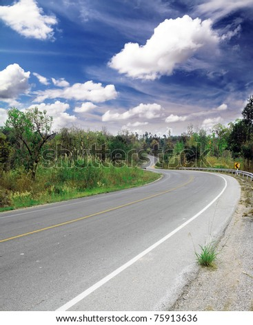 curve road and blue sky - stock photo