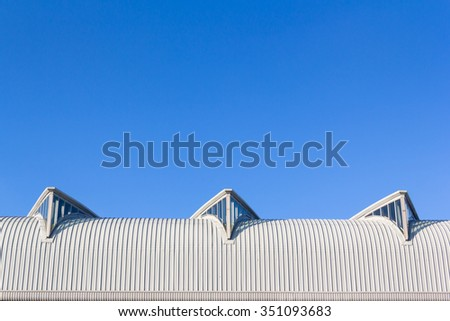 curve steel roof with glass window, modern design roof for saving light energy in building  - stock photo