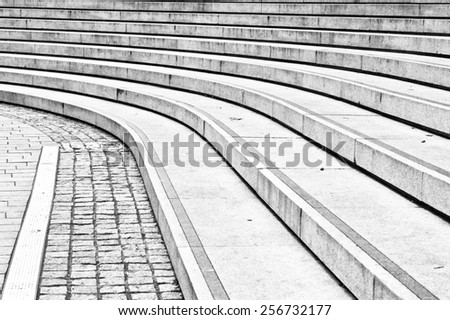 Curved concrete steps as an abstract in black and white - stock photo