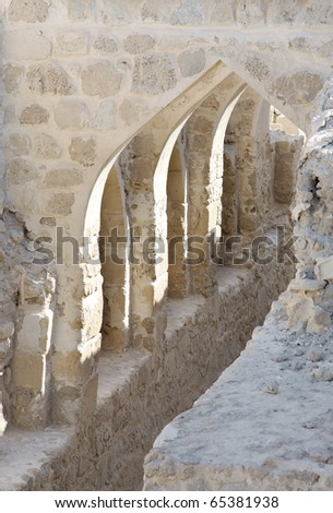 Curved masonry construction passage inside Bahrain fort - stock photo