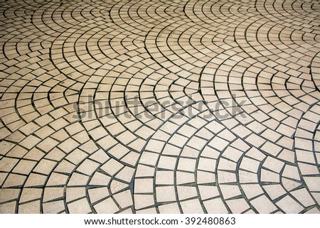 Curved mosaic pavement of small stones - stock photo