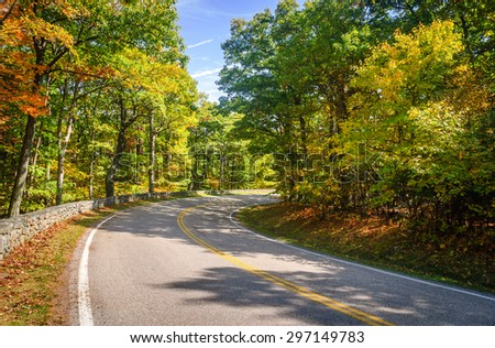 Curved Road and Autumn Trees at Shenandoah National Park - stock photo