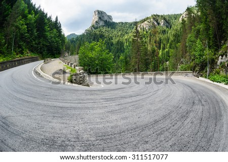 Curved road in Bicaz Canyon one of the most exciting travel road in Romania. - stock photo
