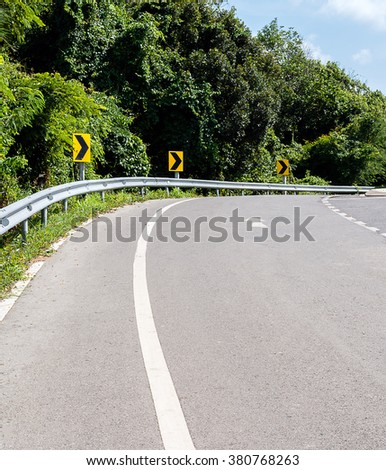 Curved road up to mountain - stock photo