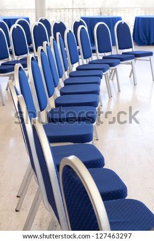 Curved row of empty conference chairs - stock photo