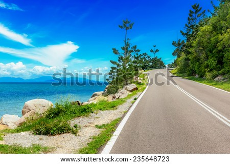 Curving road along sea in Magnetic Island, Australia - stock photo