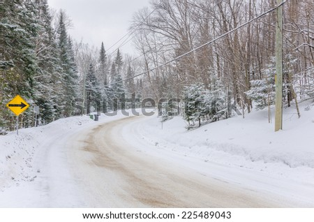 Curving Road During a Snowstorm - stock photo