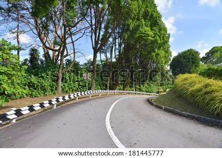 Curving Road Going Downhill - stock photo