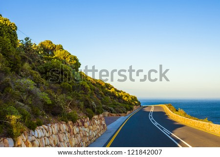 Curving road near the sea, Cape Town, South Africa - stock photo
