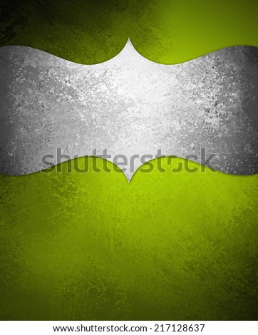 curving silver ornamental design element on bright green painted background wall, blank copyspace for text, elegant formal background with vintage texture, luxury background - stock photo